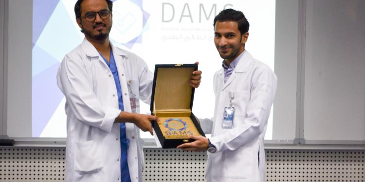 The Director of KFHU honors DAMS Volunteers